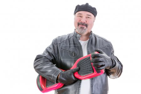 Content man in leather jacket holding hoverboard