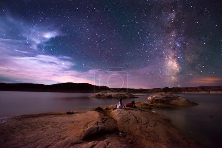 Couple looking at Beautiful Milky Way