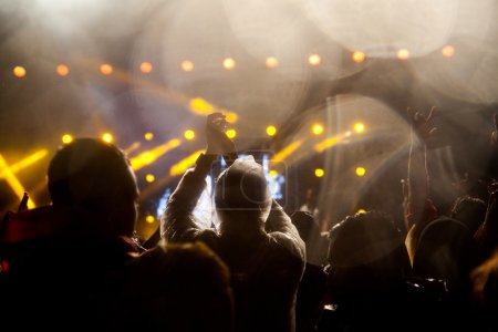 Photo for Crowd at concert and blurred stage lights - Royalty Free Image