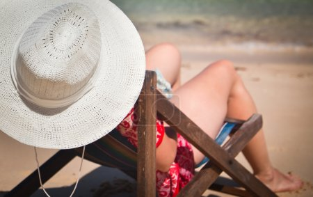 Photo for Exotic beach holiday background with white hate on beach chair - Royalty Free Image