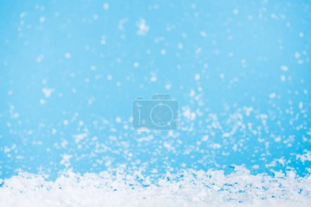 Photo for Artificial snow on blurred background, new year concept - Royalty Free Image