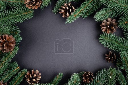 Photo for Flat lay with pine cones with fir branches on black background, new year concept - Royalty Free Image