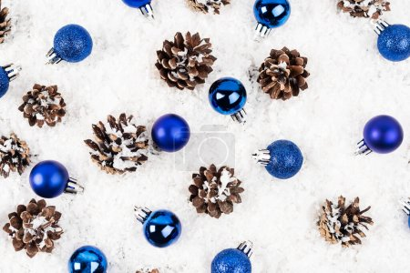 Photo for Flat lay with pine cones and christmas baubles on white textured background - Royalty Free Image