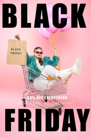 Photo for Stylish woman in sunglasses sitting in cart with shopping bags and holding balloons near black friday lettering and tag on pink - Royalty Free Image