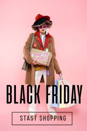 Photo for Surprised woman in sunglasses and hats with sale tags holding box with favorite shoes and shopping bags near black friday lettering on pink - Royalty Free Image