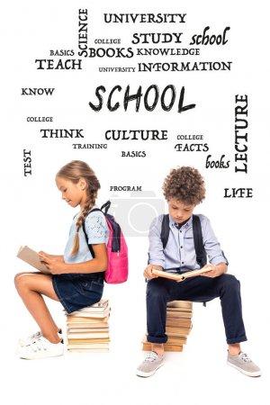 Photo pour Écoliers assis sur des livres et lisant près de lettrage sur blanc - image libre de droit