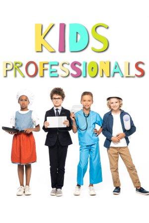 Photo pour Enfants multiculturels en costumes de différentes professions près des enfants professionnels lettrage sur blanc - image libre de droit