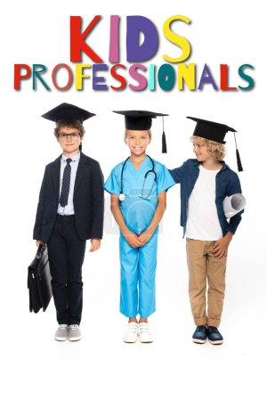 Photo pour Enfants en casquettes de graduation vêtus de costumes de différentes professions debout près des enfants professionnels lettrage sur blanc - image libre de droit