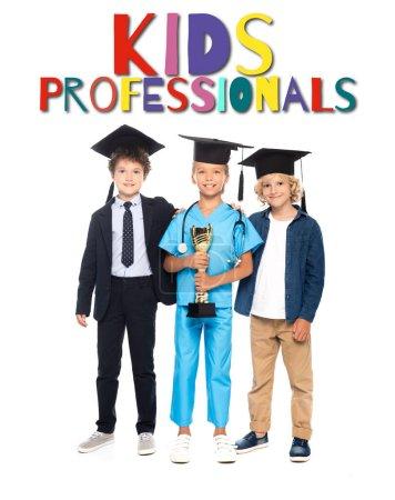 Photo pour Enfants en casquettes de graduation vêtus de costumes de différentes professions tenant trophée d'or près des enfants professionnels lettrage sur blanc - image libre de droit
