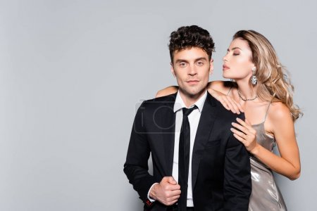 Photo for Elegant young couple posing isolated on grey - Royalty Free Image