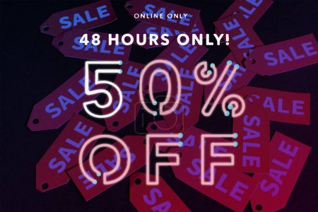 Photo for Online only, 48 hours only, 50 percent off lettering near red labels on black background - Royalty Free Image