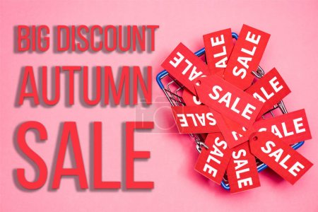 Photo for Top view of sale tags in shopping basket near big discount autumn sale lettering on pink, black friday concept - Royalty Free Image