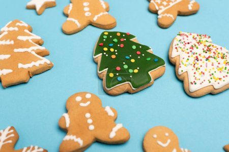 Photo for Winter gingerbread cookies on blue background - Royalty Free Image