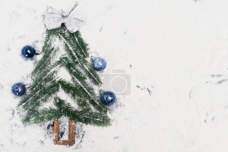 Photo for Top view of decorated Christmas tree on snow - Royalty Free Image