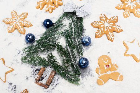 Photo for Top view of Christmas tree and gingerbread cookies on snow - Royalty Free Image