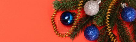 top view of decorated Christmas tree on red background, banner