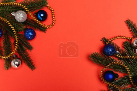 Photo for Top view of decorated Christmas tree on red background - Royalty Free Image