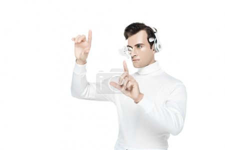 Photo for Cyborg in digital eye lens and headphones touching something isolated on white - Royalty Free Image
