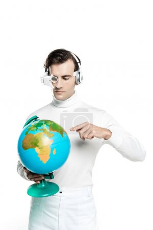 Cyborg in headphones and eye lens pointing at globe isolated on white