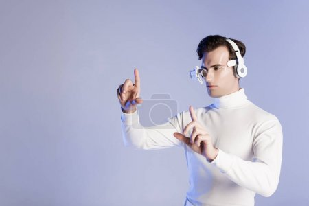 Cyborg man in headphones touching something isolated on purple