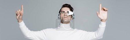 Cyborg in headphones and digital eye lens using something isolated on grey, banner