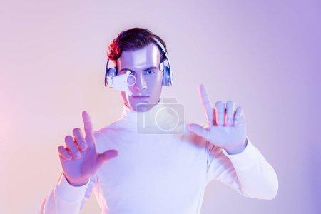 Cyborg in eye lens and headphones using something on purple background