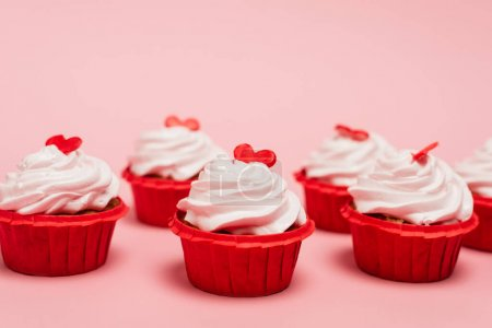 valentines cupcakes with red heart on pink background