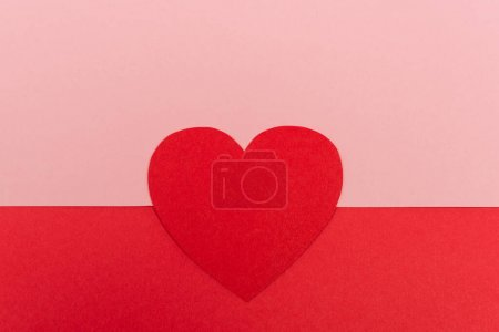 top view of paper heart on red and pink background
