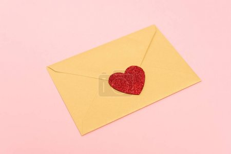top view of red heart on envelope isolated on pink