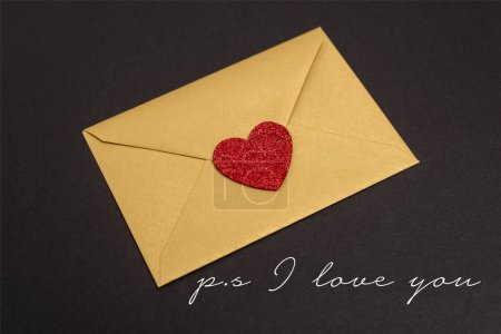 valentines envelope with heart near ps i love you lettering on black