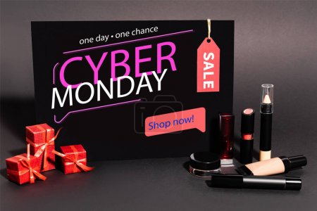 placard with one day, one chance, cyber monday lettering and gifts near decorative cosmetics on dark background