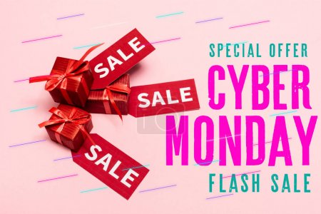 Photo for Top view of red labels and presents near special offer, cyber monday, flash sale lettering and presents on pink - Royalty Free Image