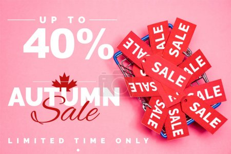 top view of sale tags in shopping basket near up to 40 percent off, autumn sale lettering on pink, black friday concept