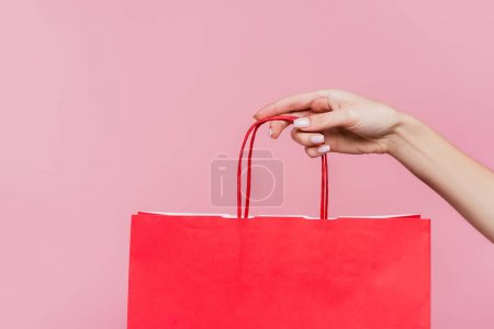 Photo for Partial view of woman holding paper bag isolated on pink - Royalty Free Image