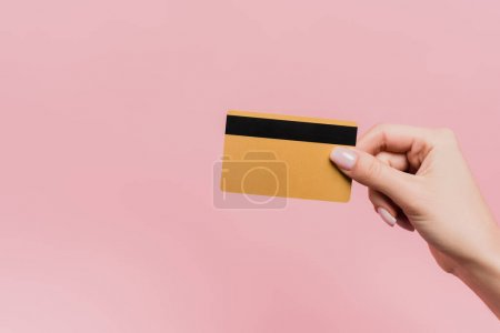 Photo for Partial view of woman holding credit card in hand isolated on pink - Royalty Free Image