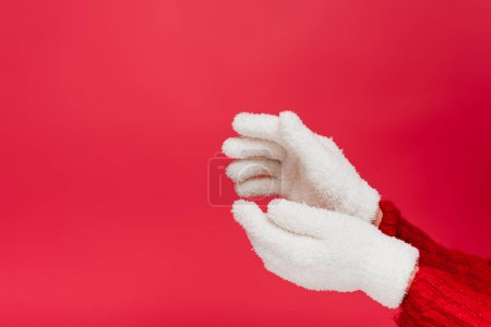 Photo for Cropped view of woman in white gloves isolated on red - Royalty Free Image