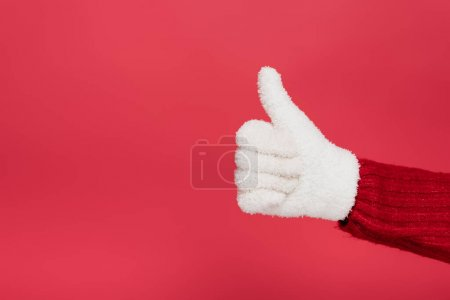 Photo for Cropped view of woman in white glove showing thumb up isolated on red - Royalty Free Image