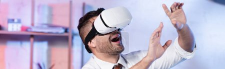 astonished architect gesturing while using vr headset, banner