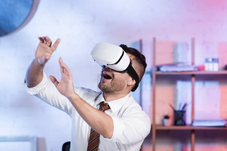 amazed architect gesturing while using vr headset in office