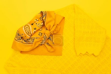 Photo for Top view of scarf with ornate on clothing isolated on yellow - Royalty Free Image