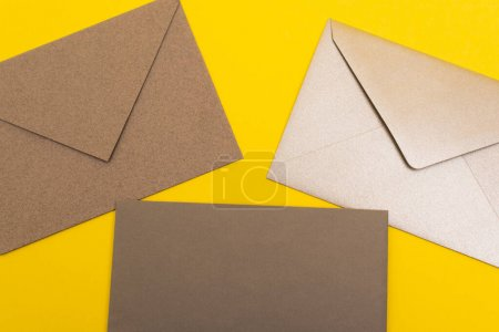 top view of paper envelopes isolated on yellow
