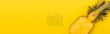 Photo for Top view of half of ripe and fresh pineapple isolated on yellow, banner - Royalty Free Image