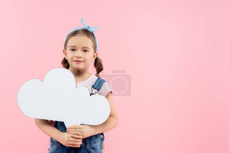 cheerful kid holding thought bubble isolated on pink