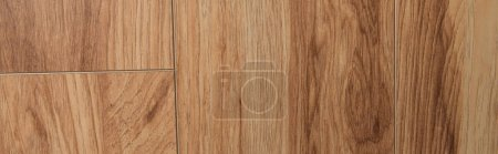 top view of brown, wooden laminate flooring background, top view, banner
