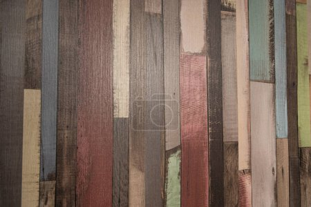 background of multicolored, narrow wooden planks, top view