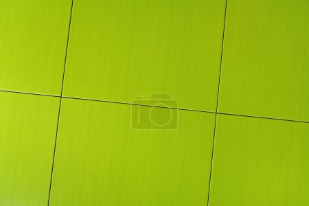 background of bright, green square tiles, top view