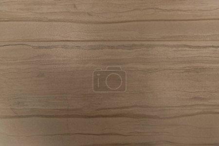 fondo de color marrón pastel, suelo laminado de madera, vista superior