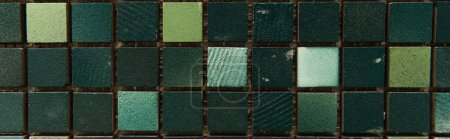 background of dark, multicolored tiles, top view, banner