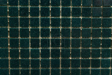 background of dark green, small tiles, top view