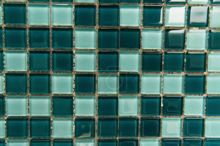 background of small, green and blue glass tiles, top view